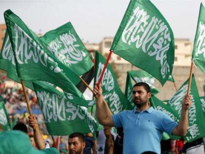 Arab-Israelis wave Islamic flags during a rally organized by the Islamic Movement on September 11, 2015 in Umm al-Fahm, an Arab-Israeli town 60 kilometers north of Tel Aviv, to show their support for preserving Muslim holy sites in east Jerusalem and to warn of the 'dangers' of Jewish extremists.