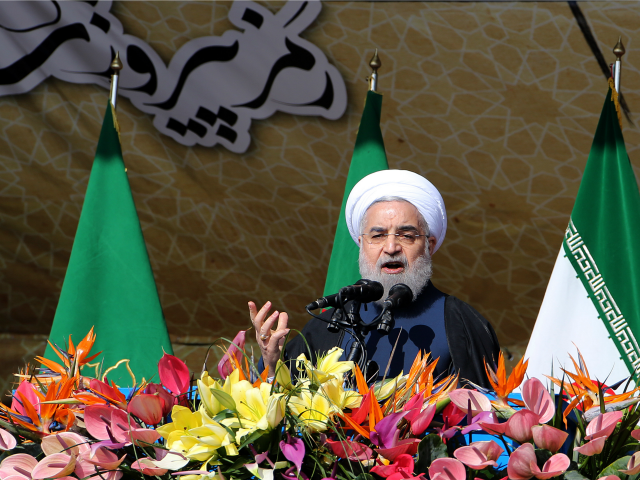 Iranian President Hassan Rouhani delivers a speech during a rally in Tehran's Azadi Square (Freedom Square) to mark the 37th anniversary of the Islamic revolution on February 11, 2016.
