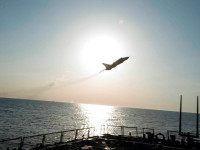 In this Tuesday, April 12, 2016 photo provided by the U.S. Navy, a Russian Sukhoi Su-24 attack aircraft makes a low altitude pass by the USS Donald Cook in the Baltic Sea. U.S. officials said the guided-missile destroyer was operating in international waters 70 nautical miles off the Russian enclave …