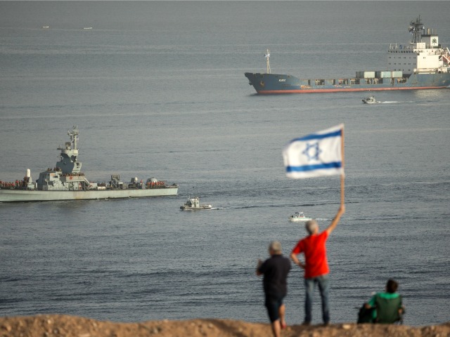The Panamanian-flagged Klos-C is escorted into the southern Israeli port of Eilat by Israeli warships on March 8, 2014 after it was intercepted by the Israeli navy with the military saying it was carrying advanced rockets from Iran to Gaza.
