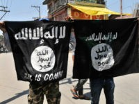 SRINAGAR, INDIA - JUNE 27: Kashmiri protesters displaying the flags of ISIS during a protest against alleged desecration of Jamia Masjid by police personnel yesterday after Friday prayers, on June 27, 2015 in Srinagar, India. Clashes broke out in several parts of downtown Srinagar on Saturday against the alleged desecration of Jamia Masjid by government forces yesterday. Reacting very sharply against police action, Auqaf Jamia Masjid, which functions under Mirwaiz, called for a shutdown in Srinagar followed by Geelani, Malik and Shah. (Photo by Waseem Andrabi/Hindustan Times via Getty Images)