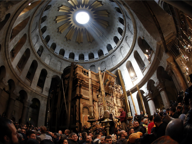 Christian Orthodox worshippers parade around Jesus' tomb ahead of lighting candles from the Holy Fire in the Church of the Holy Sepulchre, in Jerusalems Old City, on April 11, 2015 during the Orthodox Easter ceremony of the 'Holy Fire'.