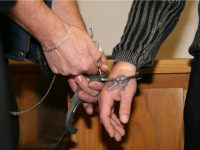 OLDENBURG, GERMANY - NOVEMBER 11: (EDITOR'S NOTE: IMAGE WAS PIXELATED AT SOURCE) Nikolai H., suspected criminal, is seen with handcuffs at his trial at the regional court Oldenburg on November 11, 2008 in Oldenburg, Germany. Nikolai H. is accused of dropping a wooden block down a highway bridge which killed a woman traveling with her family in a car. (Photo by Getty Images/GettyImages)