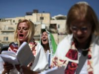 Israeli members of the liberal Jewish religious group Women of the Wall wear 'Tallit', traditional Jewish prayer shawls for men, as they pray at the Western Wall plaza outside the women's section in Jerusalem's Old City, on April 24, 2016, after they were banned from conducting the first-ever' women's priestly …