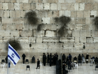 Ultra-Orthodox Jewish men (L) and women (R) pray in two different sections at the Western Wall, the most holy site where Jews can pray, in Jerusalem's Old city, on February 2, 2016.