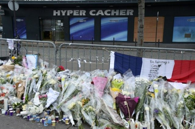 Floral tributes are laid outside a Jewish supermarket in Porte de Vincennes, Paris after it was attacked by jihadist gunman Amedy Coulibaly in January 2015