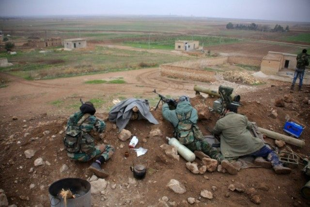 Syrian pro-government fighters hold a position near the village of Al-Najjarah, east of the northern Syrian city of Aleppo on January 7, 2016