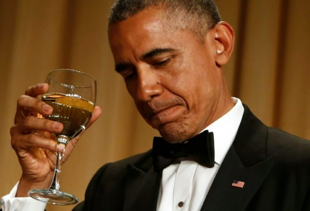 US President Barack Obama makes a toast at the White House Correspondents' Association Dinner, in Washington, DC, on April 25, 2015