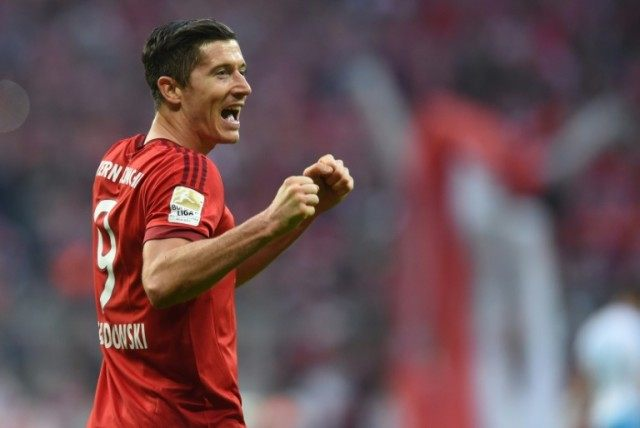 Bayern Munich's striker Robert Lewandowski celebrates scoring the 2-0 goal during the Bundesliga match vs Schalke 04 in Munich, on April 16, 2016