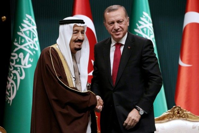 Turkish President Recep Tayyip Erdogan (R) shakes hands with King Salman of Saudi Arabia in Ankara on April 12, 2016