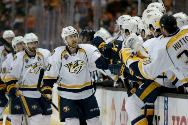 Colin Wilson (C) of the Nashville Predators skates past team's bench after scoring a goal during their NFL first round playoff game against the Anaheim Ducks, at the Honda Center in Anaheim, California, on April 27, 2016