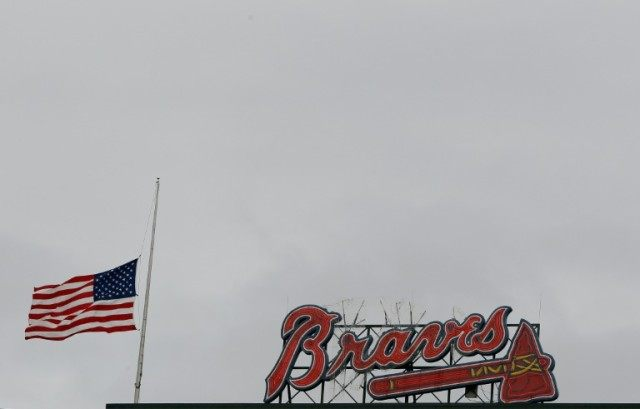 An American flag is lowered to half-staff at Turner Field in memory of a fan, Greg Murrey, who fell to his death at an Atlanta Braves game on August 29, 2015