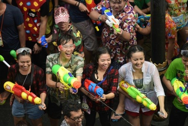 Thailand's new year festival Songkran is known as one of the world's biggest water fights, with crowds of revellers battling in the streets and dousing passers-by