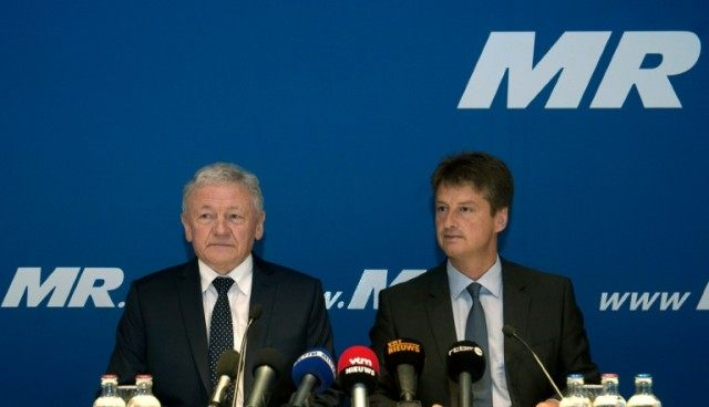 Belgium's newly appointed Transport Minister Francois Bellot (L) and liberal party reformist movement (MR) chairman Olivier Chastel give a press conference at the MR headquarters in Brussels on April 17, 2016