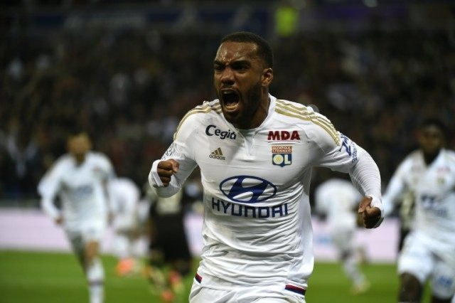 Lyon's forward Alexandre Lacazette celebrates after scoring during the L1 football match against Nice on April 15, 2016