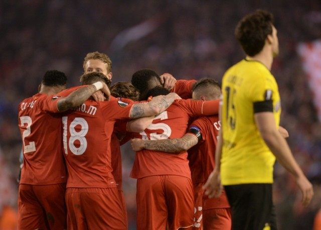 Liverpool players celebrate after winning the Europa league quarter-final against Borussia Dortmund at Anfield on April 14, 2016