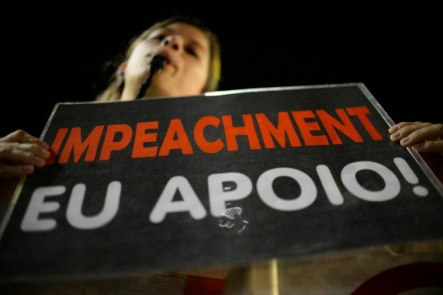 Activists supporting the impeachment of President Dilma Rousseff take part in a protest near the Congress, in Brasília