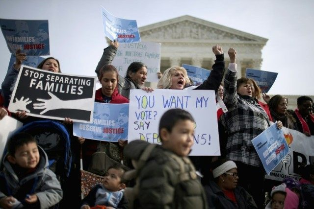 Pro-immigration reform demonstrators rally outside the United States Supreme Court in Washington, DC