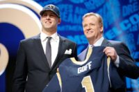Jared Goff (L) stands next to NFL Commissioner Roger Goodell after being picked number one overall by the Los Angeles Rams during the 2016 NFL Draft