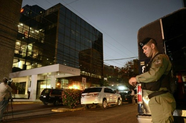 Police stand guard outside the Mossack Fonseca law firm offices in Panama City during a raid on April 12, 2016