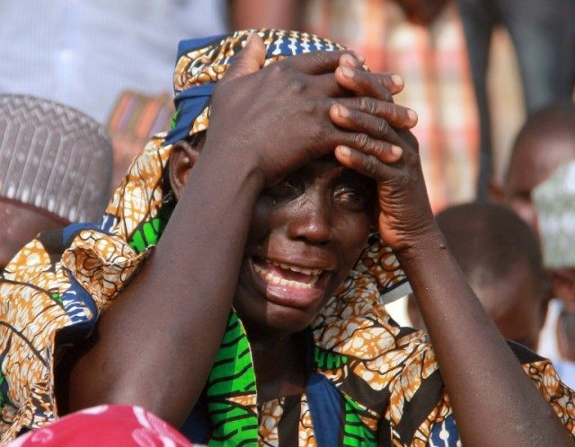 A mother cries for her missing daughter, abducted by Boko Haram Islamists in 2014 along with more than 200 other schoolgirls, during a march to press for their release, in Abuja on January 2016