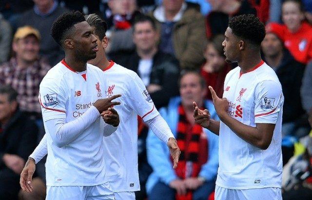 Liverpool's Daniel Sturridge (L) celebrates scoring his team's second and winning goal against Bournemouth on April 17, 2016