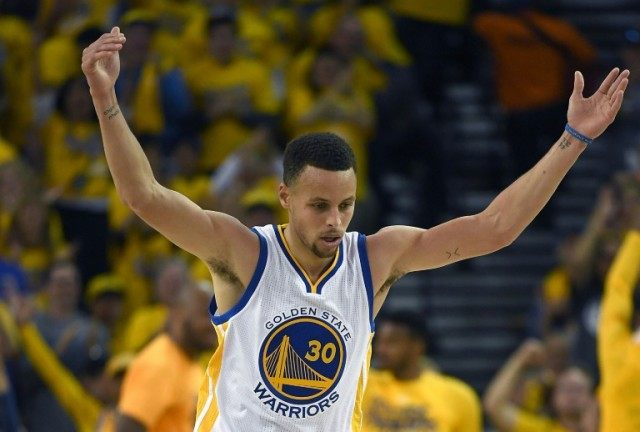 Stephen Curry of the Golden State Warriors reacts after hitting a three-point shot against the Houston Rockets in the second quarter in Game One during the 2016 NBA Playoffs, on April 16, 2016 in Oakland, California