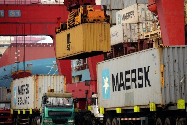Chinese exports surged in March, the first gain in nine months, new figures show