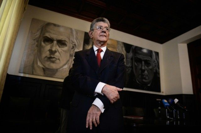 The president of the Venezuelan National Assembly, Henry Ramos Allup, stands during a press conference to evaluate the first 100 days of parliamentary work, in Caracas on April 14, 2016