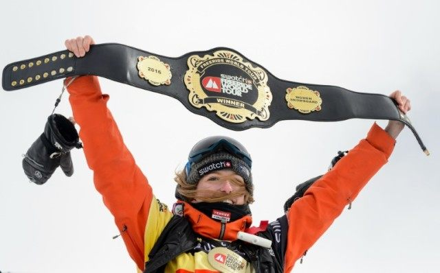 World snowboard champion Estelle Balet holds up her overall belt after she won the women's event at the Bec des Rosses during the Verbier Xtreme Freeride World Tour final on April 2, 2016, near the Swiss Alps resort of Verbier