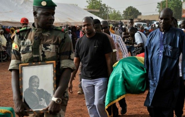 The send off for Malian photographer Malick Sidibe, whose coffin was draped in the national flag, took place in a working class neighbourhood of Bamako, with soldiers giving the iconic artist full honours