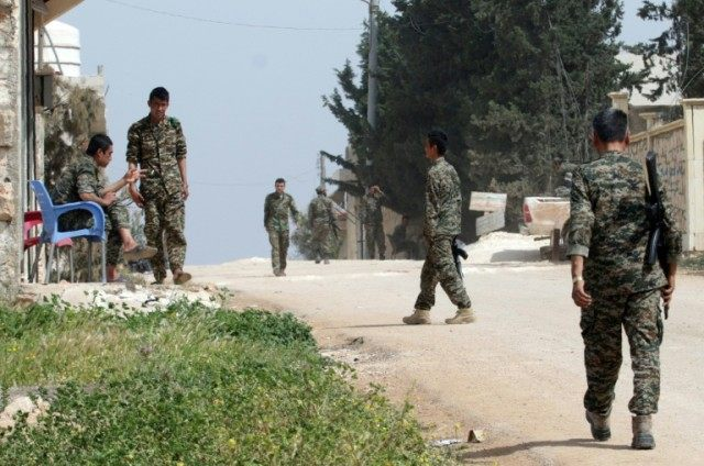 Syrian government forces patrol the town of Khan Tuman, south of the city of Aleppo in northern Syria, on April 11, 2016