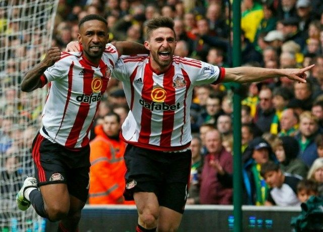 Sunderland striker Jermain Defoe (L) celebrates with teammate Fabio Borini after scoring their second goal during the English Premier League match against Norwich City at Carrow Road in Norwich, eastern England, on April 16, 2016