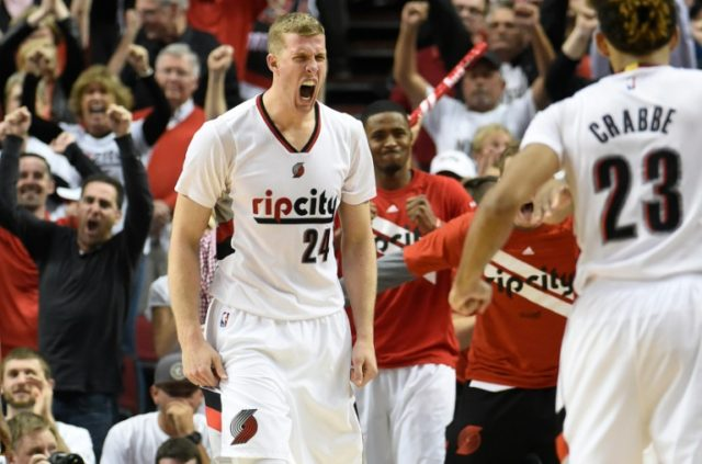 Mason Plumlee (L) of the Portland Trail Blazers celebrates with Allen Crabbe after grabbing a rebound in Game Six of the Western Conference Quarterfinals against the Los Angeles Clippers