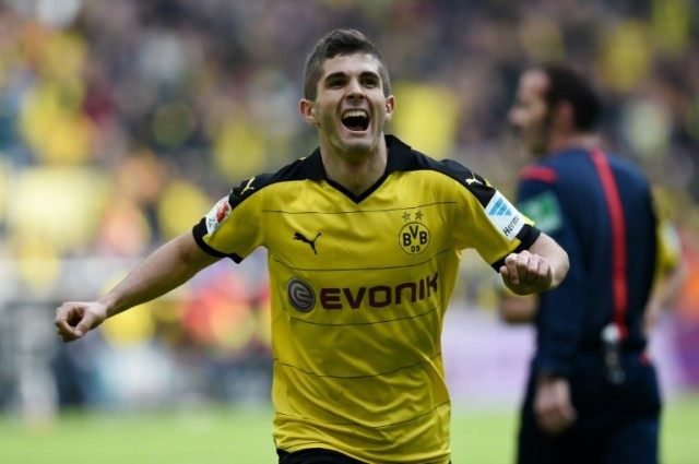 Dortmund midfielder Christian Pulisic celebrates scoring against Hamburg during the German Bundesliga first division match in Dortmund, western Germany, on April 17, 2016