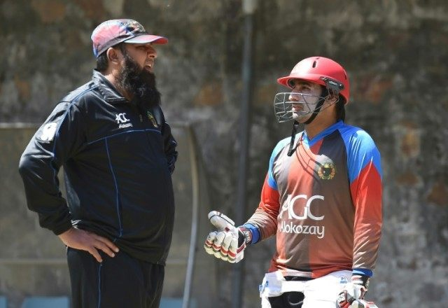 Afghanistan cricket coach Inzamam-ul-Haq (L) talks with captain Asghar Stanikzai during a training session at Feroz Shah Kotla cricket ground in New Delhi on March 22, 2016