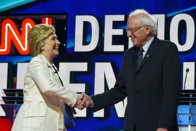The CNN Democratic Presidential Debate between candidates Hillary Clinton (L) and Bernie Sanders got off to an acrimonious start