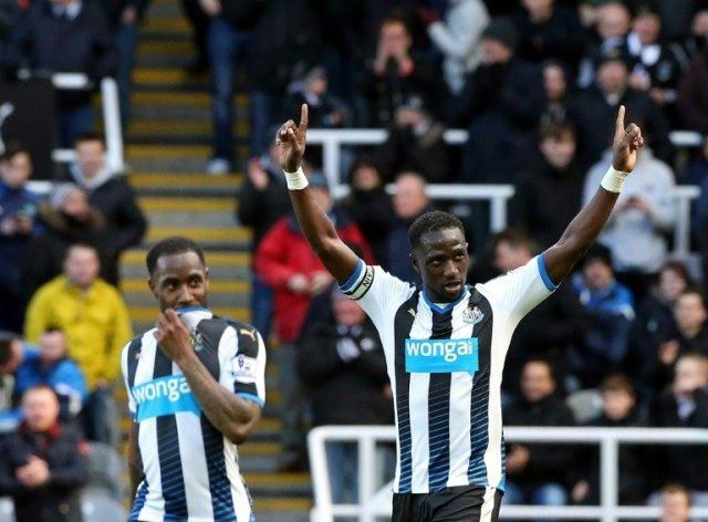Newcastle United's midfielder Moussa Sissoko (R) celebrates after scoring their second goal during the English Premier League match against Swansea City on April 16, 2016