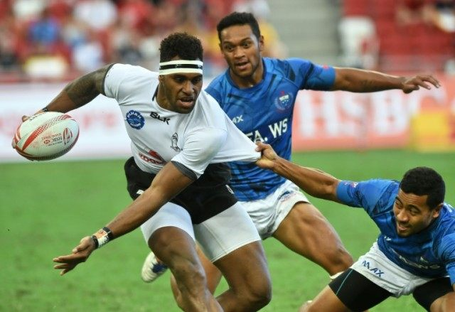 Fiji's Semi Kunatani is tackled by a Samoa player during their match at the Singapore Rugby Sevens tournament on April 16, 2016