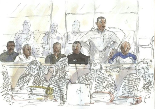 A court sketch made on March 29, 2016 shows seven suspected Somali pirates attending their trial in the courthouse in Paris, over the hijacking of a French yacht