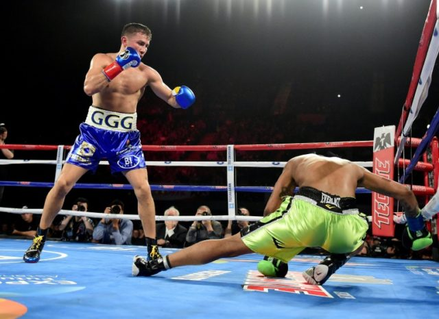 Gennady Golovkin knocks down Dominc Wade for the second time on the way to a second round TKO during his unified middleweight title fight in Inglewood, California