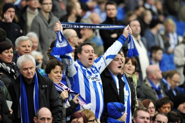 Brighton fans sing in the crowd at stadium in, Brighton, southern England on January 5, 2013