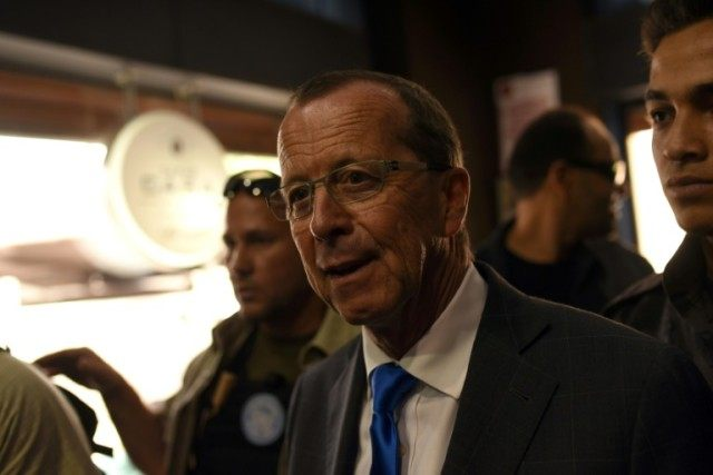 The UN envoy for Libya, Martin Kobler (C) meets Libyans during a tour in the Tripoli's old city on April 5, 2016