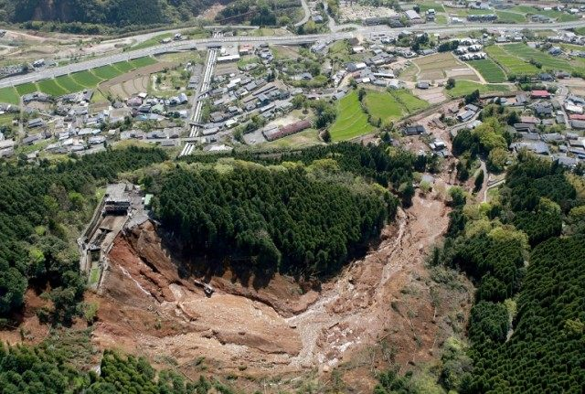 The Kurokawa Dai-ichi Power Plant (front, L) pictured next to a landslide after an earthquake in Minami-Aso, Kumamoto prefecture, southern Japan on April 16, 2016