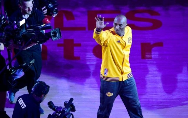 On a night of searing emotion at a packed Staples Center, Kobe Bryant signed off with a mammoth 60 points, to inspire a 101-96 victory over the Utah Jazz