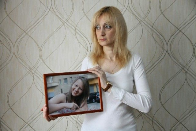 Yelena Sablina holds a photo of her daughter Alina who died after being hit by a speeding car