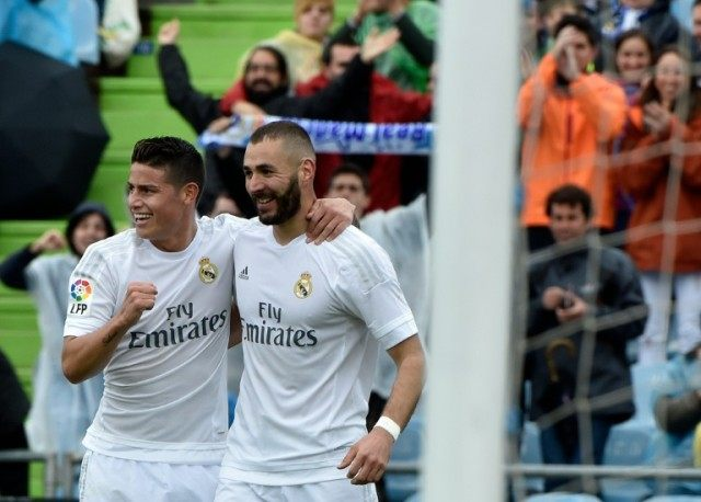 Real Madrid's forward Karim Benzema (R) celebrates a goal with James Rodriguez during the match against Getafe on April 16, 2016