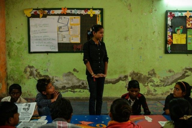 Reporter for the 'Balaknama' newspaper, Durga Kumari, 15, speaks during an editorial meeting in the paper's newsroom in New Delhi