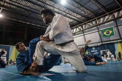 Congolese judoka Popole Misenga (R) is pushing to compete in the Rio Olympics as part of the Games' first stateless team