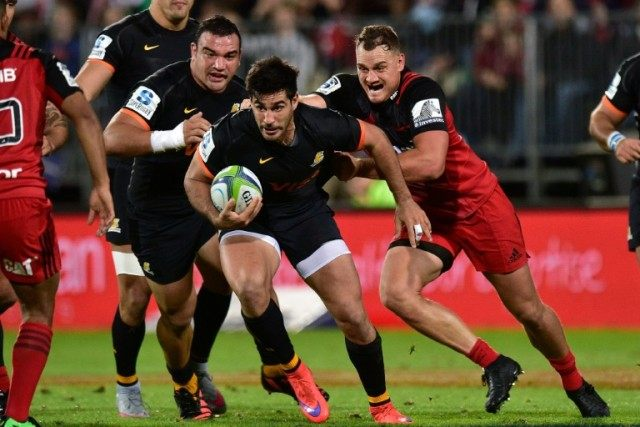 Jerunimo de la Fuente (C) of the Jaguares is tackled by Israel Dagg (R) of the Canterbury Crusaders during the Super Rugby match in Christchurch on April 15, 2016